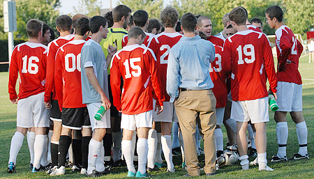 men's soccer huddle